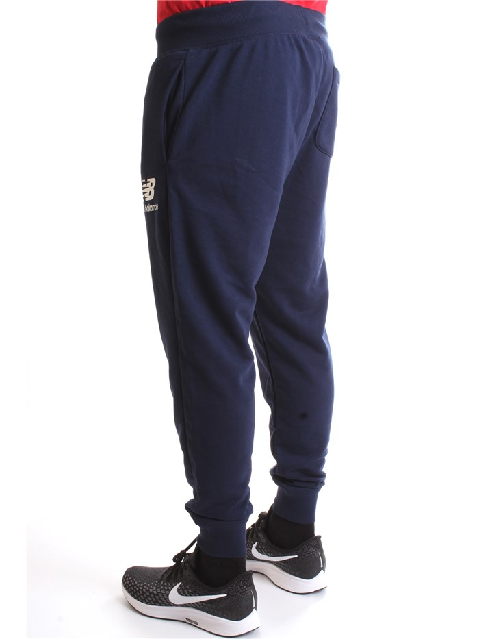 NEW BALANCE MP03579 Blue Clothing Man Trousers